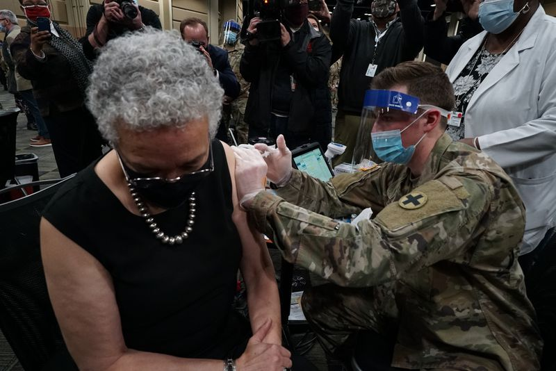 Cook County Board President Toni Preckwinkle receives a vaccine shot at the vaccination site in the Tinley Park Convention Center in January.