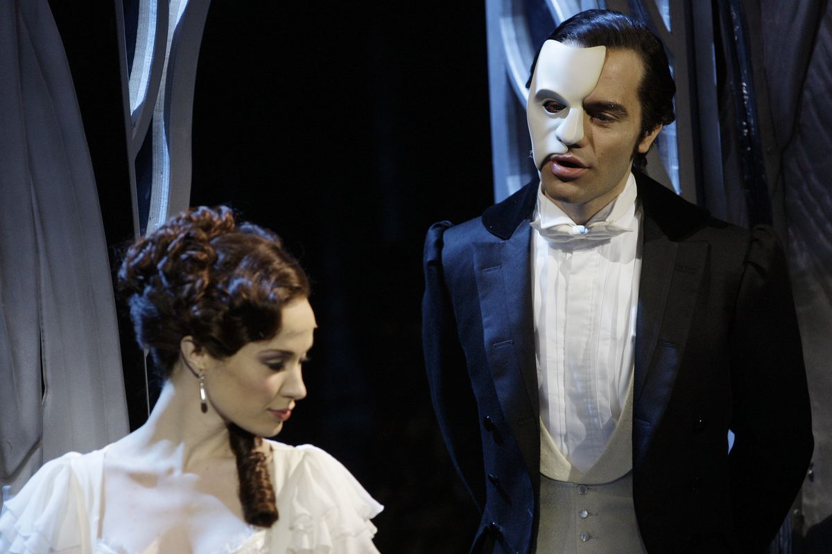 The Phantom, played by Ramin Karimloo, right, performs a scene with Christine, played by Sierra Boggess.