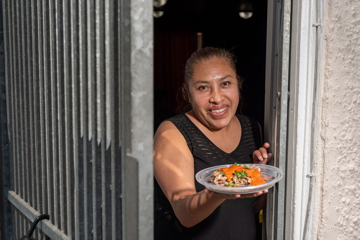 Norma Morales serves traditional Hildaguese barbacoa at her home in San Francisco.
