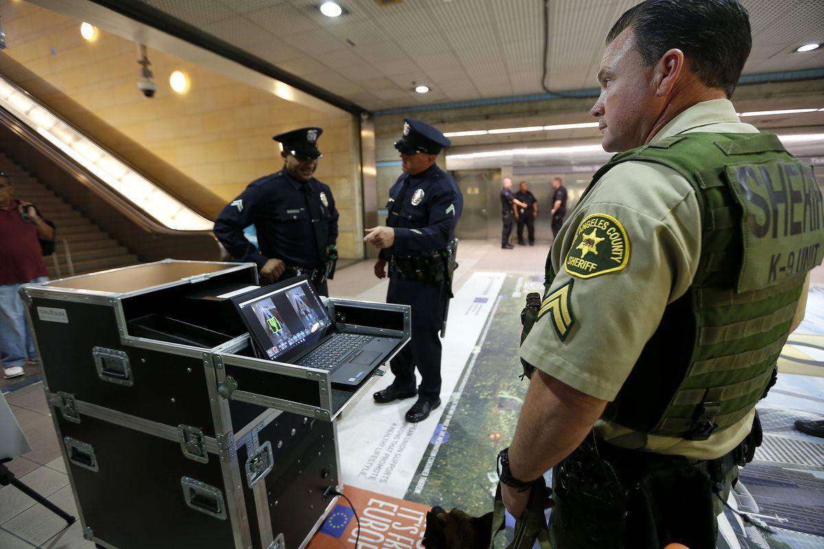 Officers using Metro security scanner