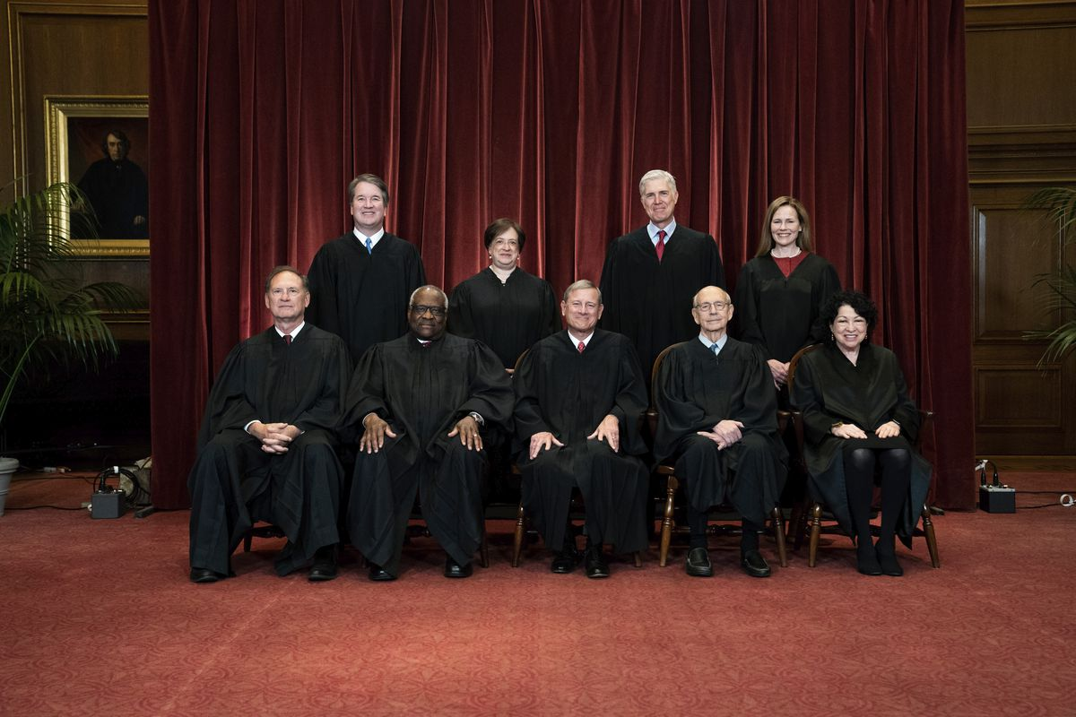 In this April 23, 2021, file photo members of the Supreme Court pose for a group photo at the Supreme Court in Washington.