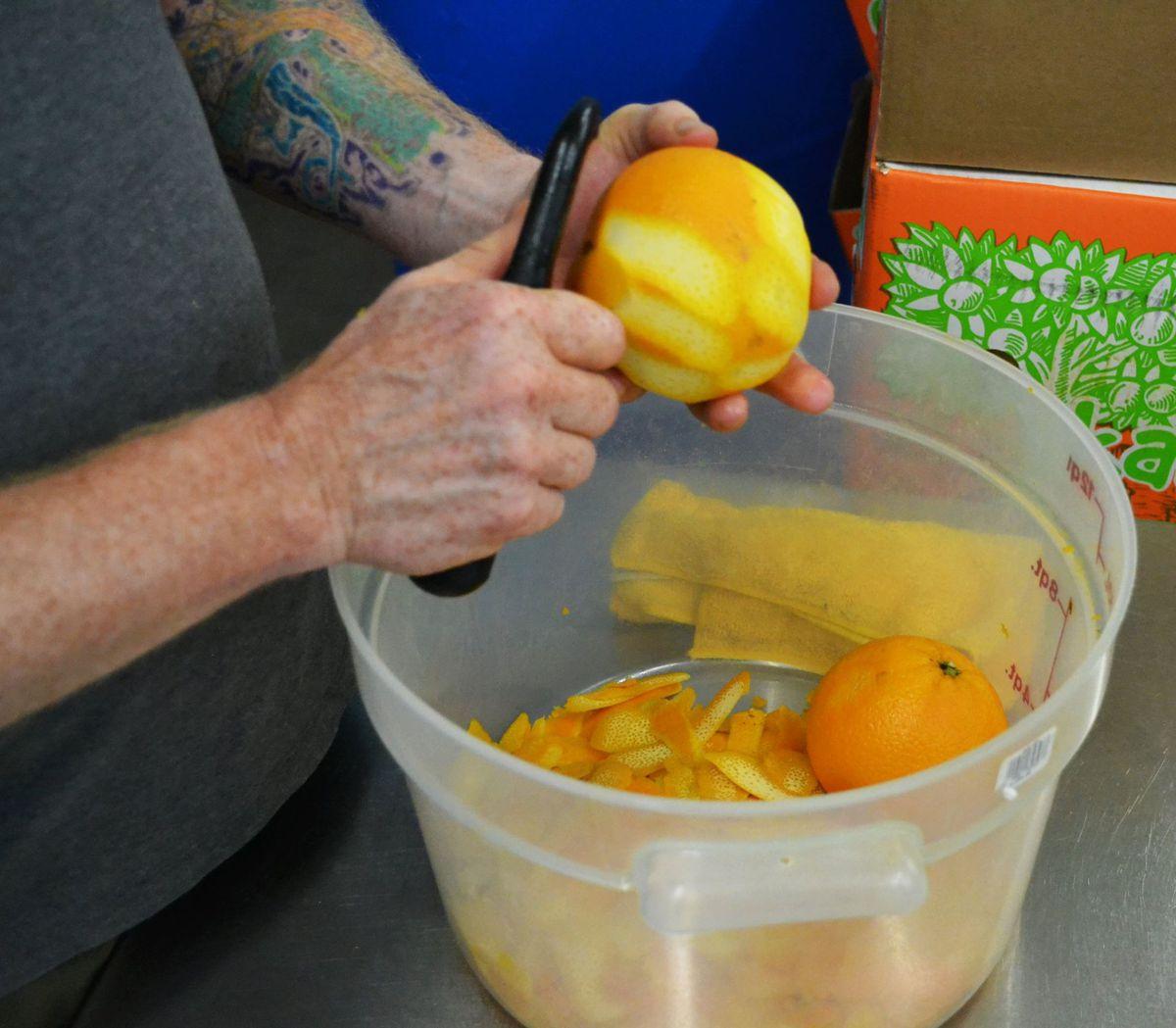 Peeling oranges for Paula's Texas Orange