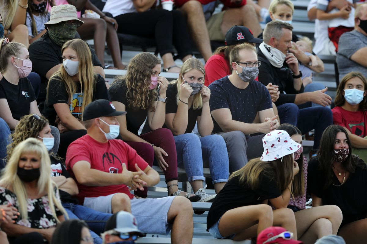 Spectators wear masks while watching the American Fork vs. Timpview high school football game in American Fork on Thursday, Aug. 20, 2020.