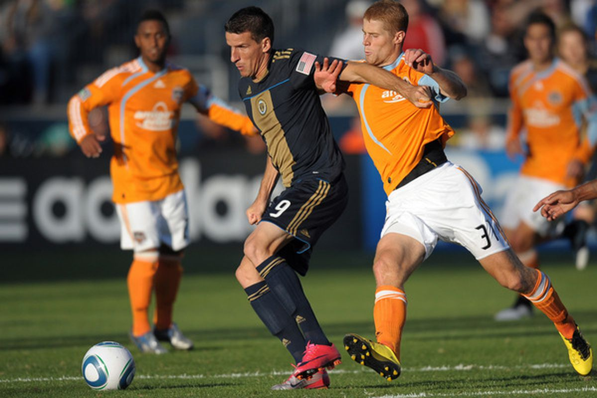 CHESTER PA- OCTOBER 2: Sebastien Le Toux #9 of the Philadelphia Union fights to control the ball with Andrew Hainault #31 of the Houston Dynamo at PPL Park on October 2 2010 in Chester Pennsylvania. (Photo by Drew Hallowell/Getty Images)