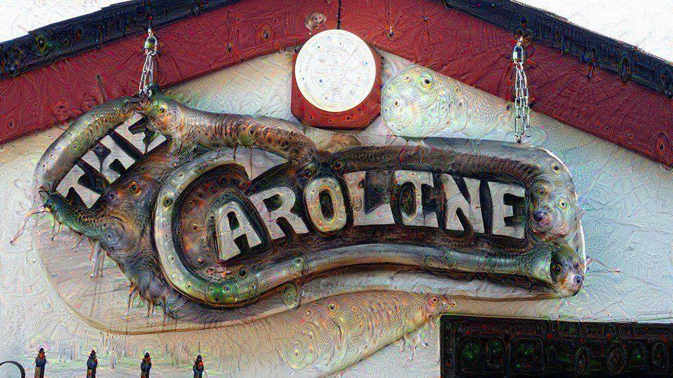 A carved wood sign outside Caroline Tavern in Lake City.
