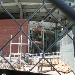 11:29 a.m. Working on the Sheffield side of the main bleacher gate (Gate 10) -