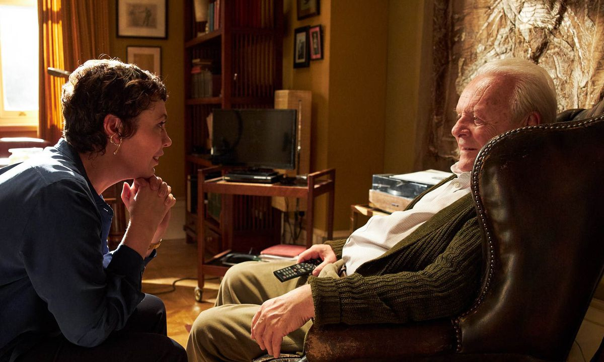 Olivia Colman and Anthony Hopkins sit in a living room in The Father
