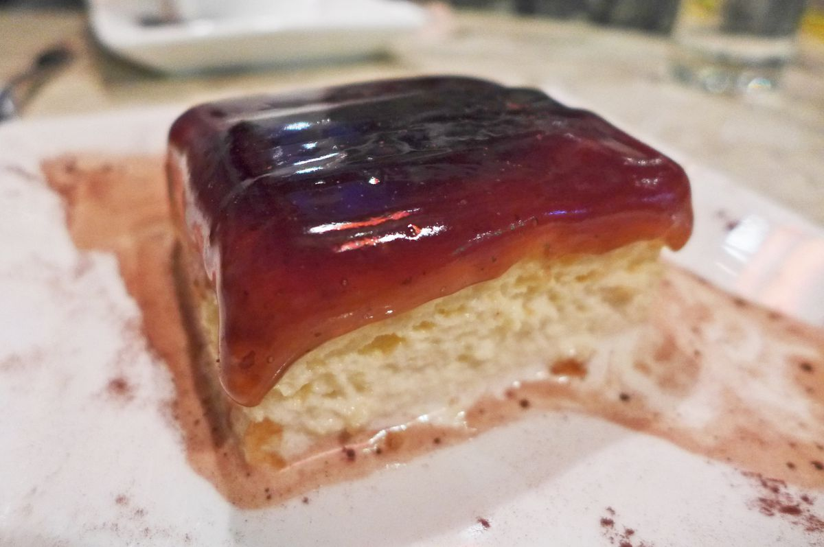 A glistening whitely damp cake with translucent caramel pouring over the top.