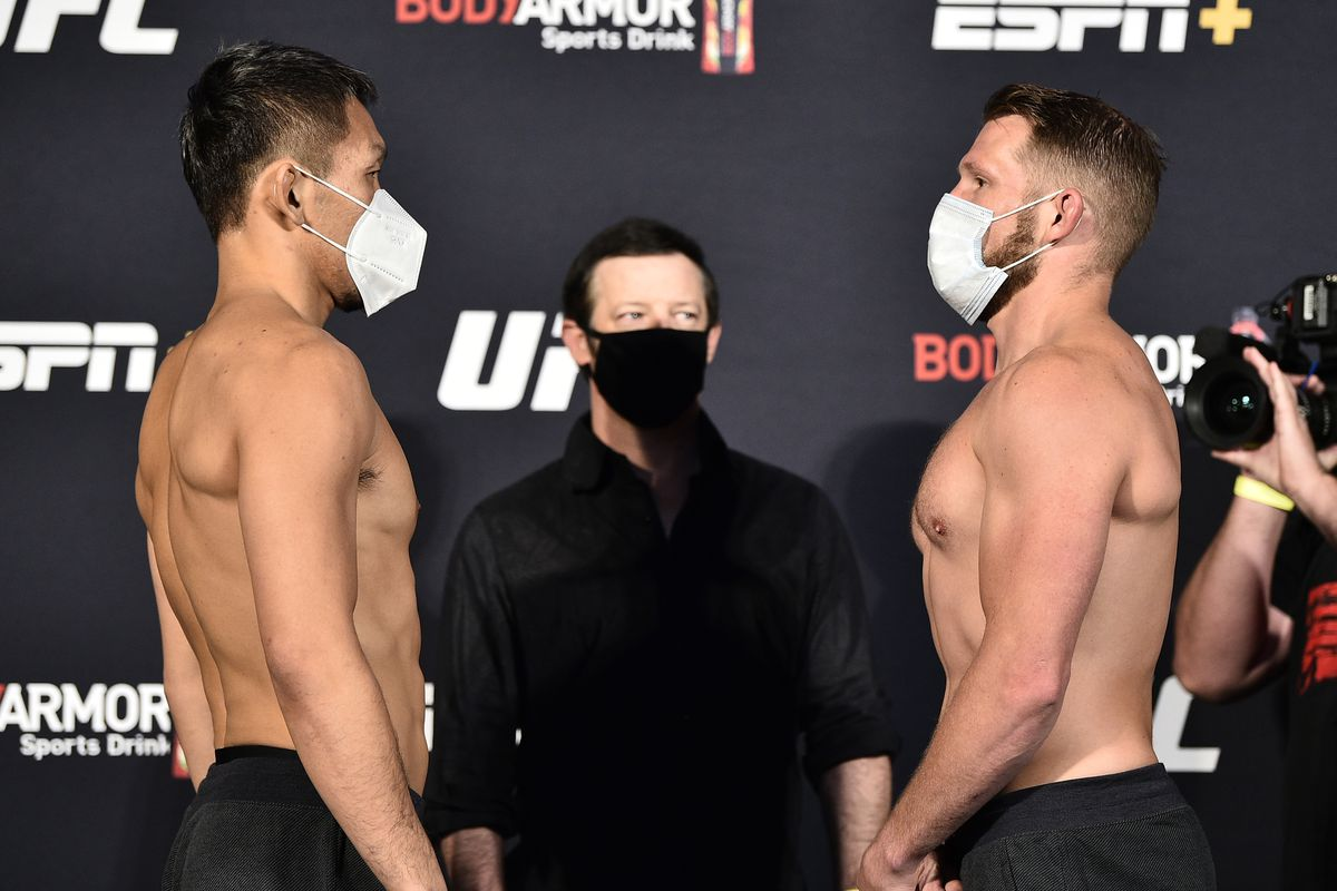 Opponents Takashi Sato of Japan and Jason Witt face off during the UFC weigh-in at UFC APEX on June 26, 2020 in Las Vegas, Nevada.