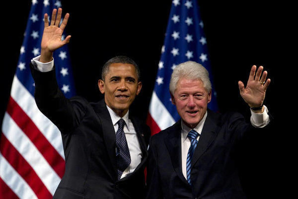 President Barack Obama and former President Bill Clinton wave to the crowd after speaking at a campaign event at the New Amsterdam Theatre, Monday, June 4, 2012, in New York.