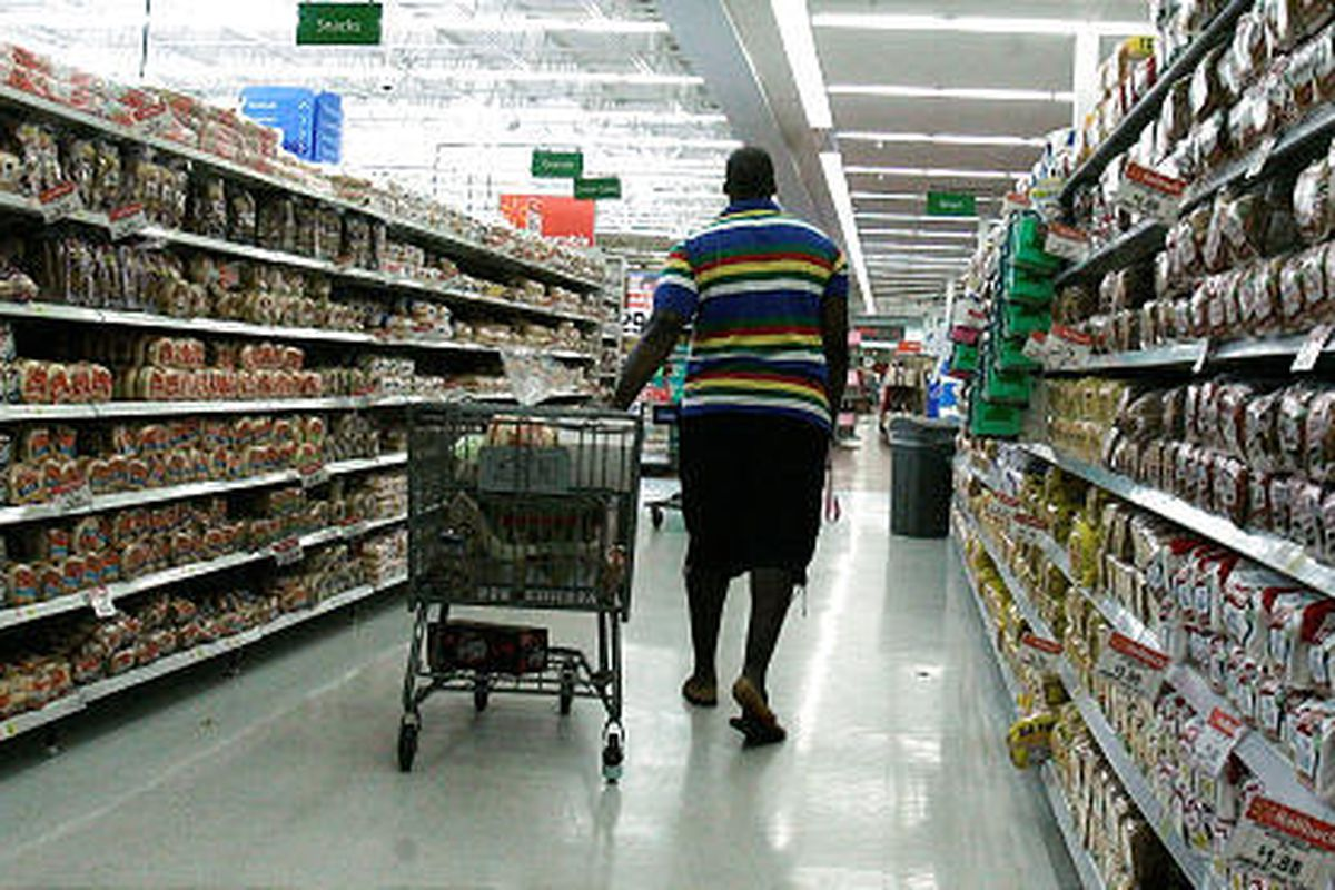 A shopper cruises the bread aisle at a Wal-Mart store Thursday in Tallahassee, Fla.