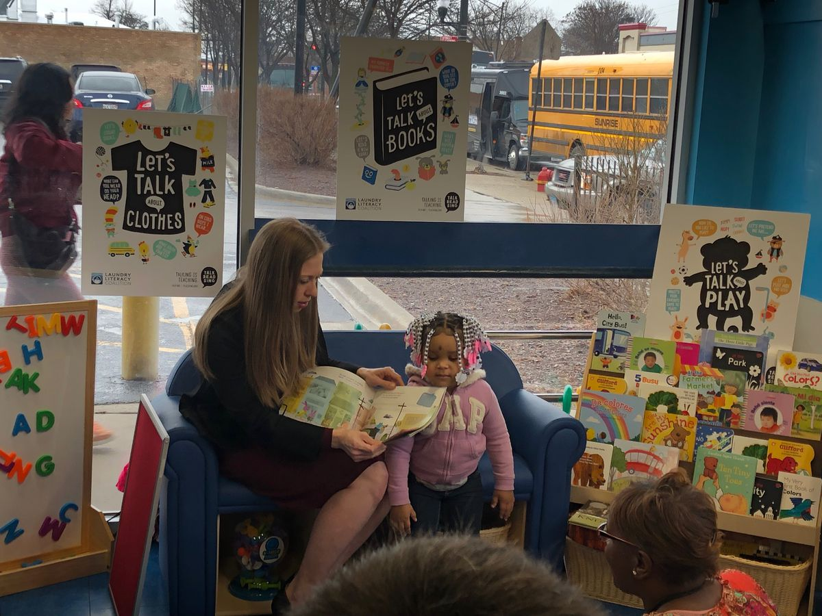 Clinton visited a Hermosa laundromat to help promote an early literacy program championed by her Too Small to Fail organization.