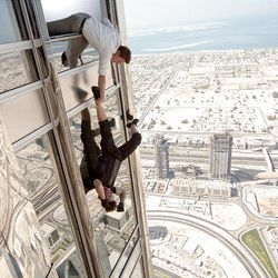 """Jeremy Renner as Brandt grabs Tom Cruise as Ethan Hunt in the famous scene from Dubai in the popular """"Mission: Impossible – Ghost Protocol,"""" out this week on DVD."""