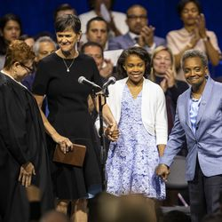 With her wife, Amy Eshleman, and daughter Vivian looking on, Lori Lightfoot is sworn is as mayor of Chicago during the city of Chicago's inauguration ceremony at Wintrust Arena, Monday morning, May 20, 2019.