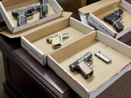 Guns seized by the Cook County sheriff's office in 2013 during visits to homes of people with revoked gun licenses. | Sun-Times file photo.