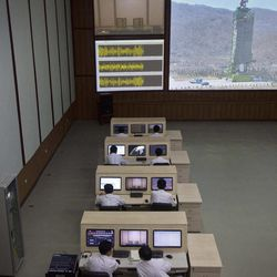 North Korean technicians man computer terminals at North Korea's space agency's General Launch Command Center on the outskirts of  Pyongyang Wednesday, April 11, 2012. Engineers are pumping fuel into a rocket that is set to carry a satellite into space, officials at the North Korean space agency's central command center said Wednesday, showing reporters a live feed of the west coast launch pad.
