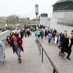 Conferencegoers make their way to the Conference Center in Salt Lake City prior to the Sunday morning session of the LDS Church's 187th Annual General Conference on Sunday, April 2, 2017.