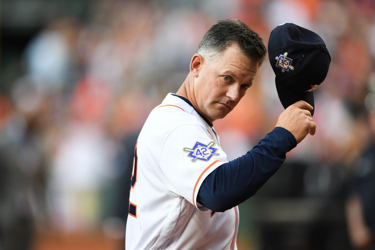 Houston Astros manager A.J. Hinch walks off the field as he wears patches honoring Jackie Robinson day before the game against the Texas Rangers at Minute Maid Park.