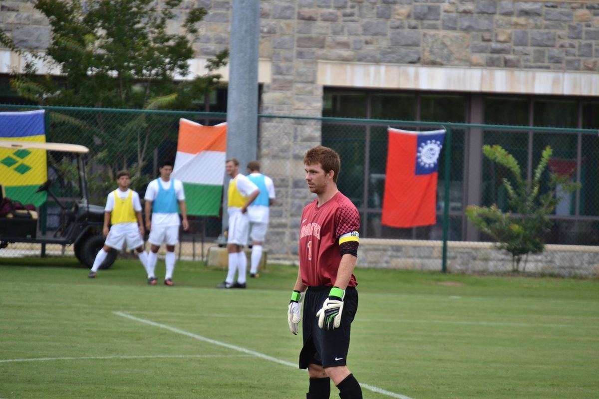 Preseason All-ACC Second Team goalkeeper Kyle Renfro watches during warmup.