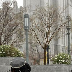 Attendees make their way in the rain and snow prior to  the 182nd Annual General Conference for The Church of Jesus Christ of Latter-day Saints in Salt Lake City  Sunday, April 1, 2012.