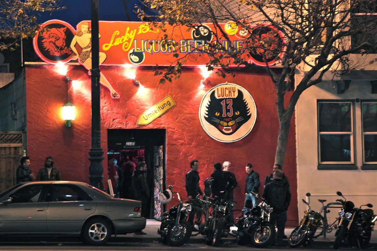 The Lucky 13 bar, a bright red building with a cat's head logo on its sign.