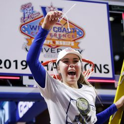 BYU Cougars guard Shaylee Gonzales (2) holds up her piece of net as BYU celebrates their win over Gonzaga for the WCC tournament championship at the Orleans Arena in Las Vegas on Tuesday, March 12, 2019. BYU won 82-68.