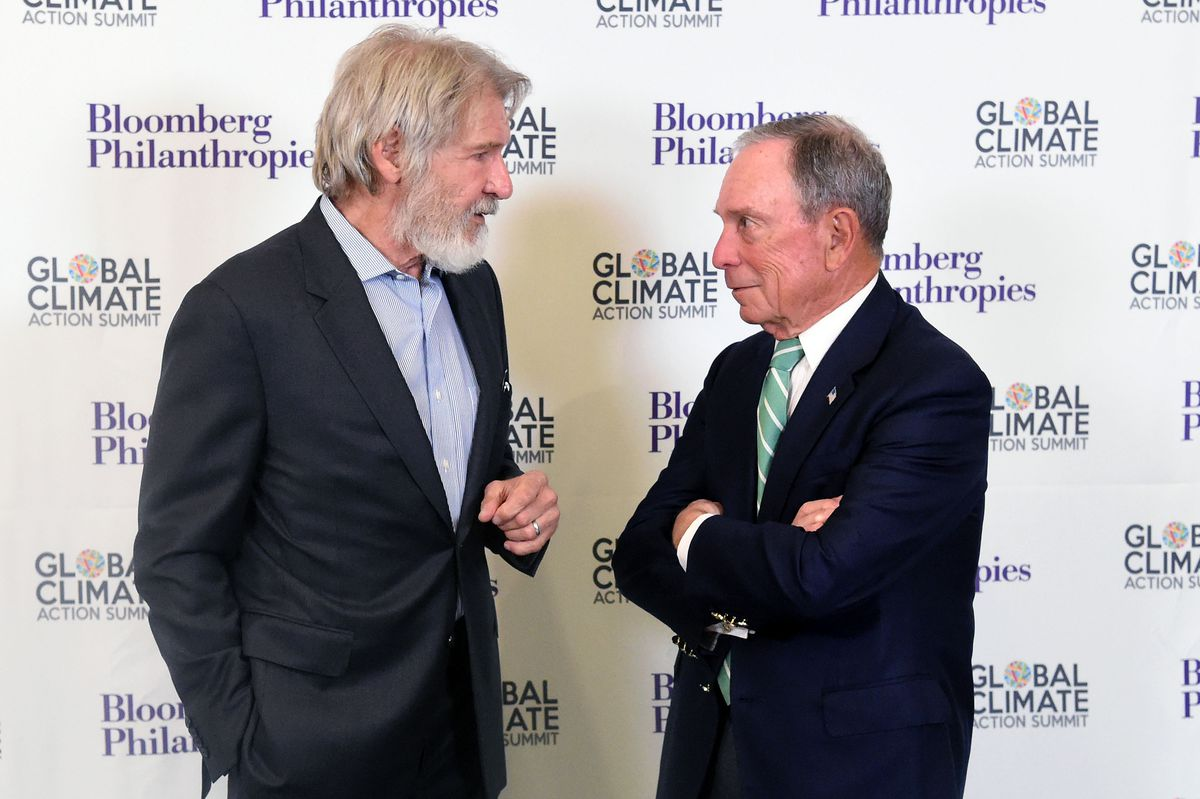 Former New York Mayor Michael R. Bloomberg (R) speaks with US actor Harrison Ford (L) during the opening reception for the Global Climate Action Summit in San Francisco, California on September 12, 2018.
