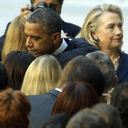 President Barack Obama, accompanied by Secretary of State Hillary Rodham Clinton, greets State Department personnel in the courtyard of the State Department in Washington,  Wednesday, Sept. 12, 2012, after speaking at the White House concerning the recent deaths of Americans in Libya. (AP Photo/Alex Brandon)