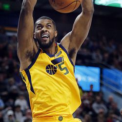 Utah Jazz forward Derrick Favors dunks the ball during NBA basketball against the Los Angeles Clippers in Salt Lake City on Saturday, Jan. 20, 2018.