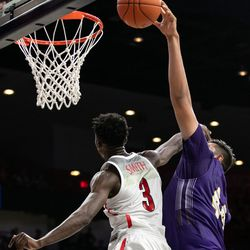 Arizona's Dylan Smith (3) elbows his way into a shot attempt by Western New Mexico's Alfredo Rodriguez (44) during the Arizona-Western New Mexico University game in McKale Center on October 30 2018 in Tucson, Ariz. Smith finished with seven points on 3-of-5 shooting.