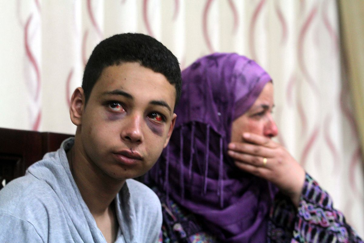 Tariq Abu Khdeir and his mother meet with Palestinian President Mahmoud Abbas several days after Khdeir's arrest.