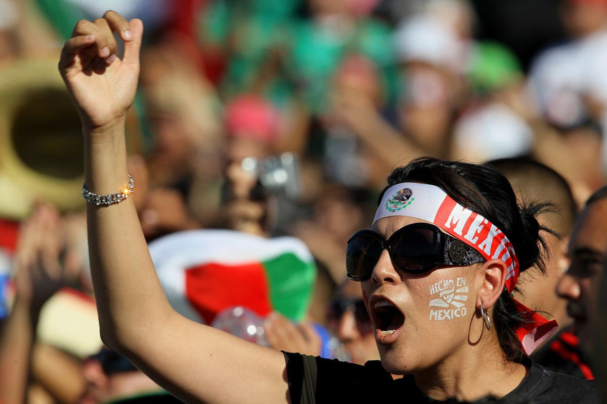 PASADENA, CA - JUNE 25:  A Mexico fan cheers before the game withthe United States during the 2011 CONCACAF Gold Championship at the Rose Bowl on June 25, 2011 in Pasadena, California.  (Photo by Stephen Dunn/Getty Images)