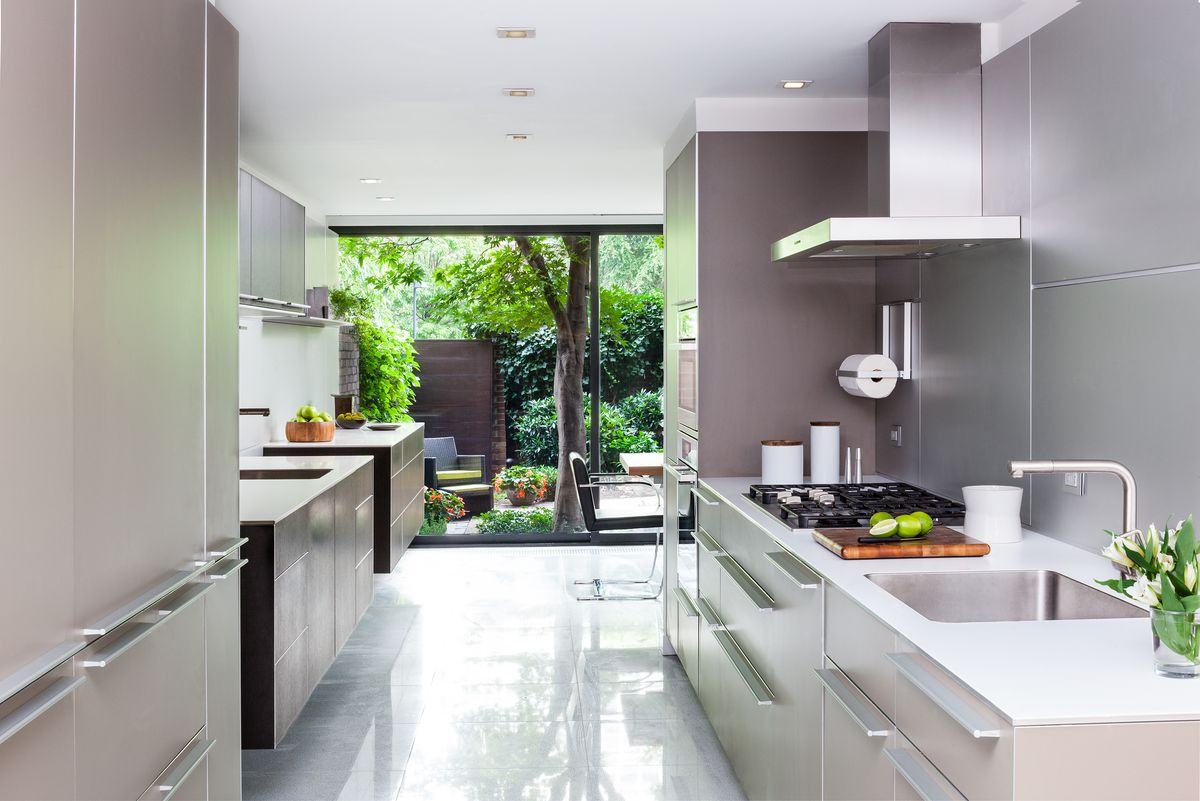A kitchen features metal cabinets and metal-lined walls.