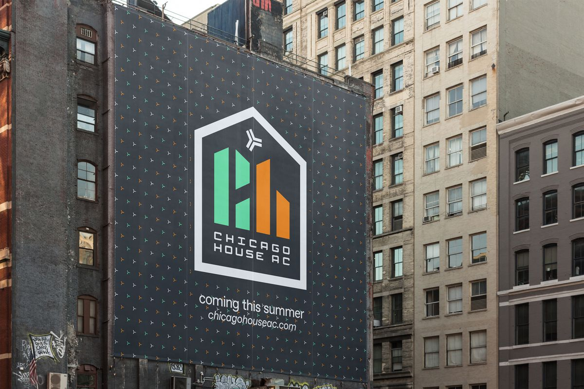 The Chicago House AC logo is displayed on the side of a city building.