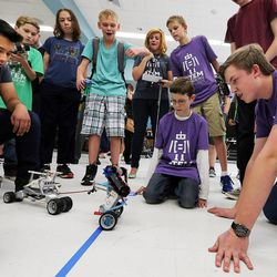 Allan Rxtun, left, of Joel P. Jensen Middle School, defeats Jonathan Young, center and Nathan Sill of Oquirrh Hills Middle School during robot tug of war as middle school students who have been involved in an after-school STEM program compete in West Jordan on Wednesday, May 27, 2015. Allan won the tug of war competition for the event.