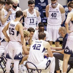 The BYU Cougars huddle during their game against the Boise State Broncos on Dec. 9, 2020 at the Marriott Center in Provo, Utah.