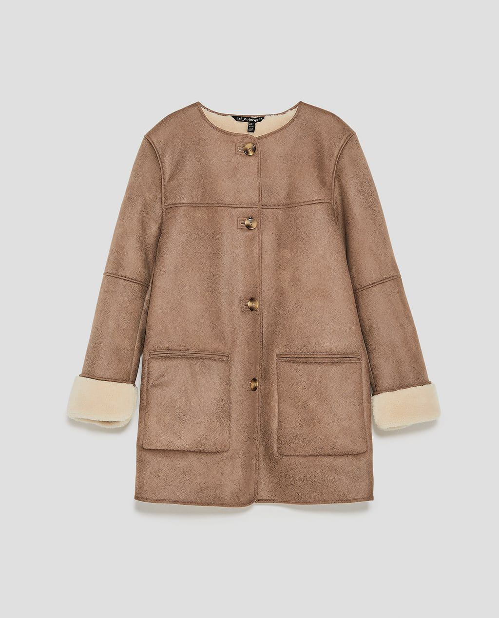 A faux shearling and suede coat