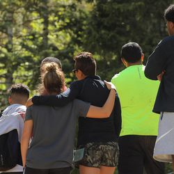 Relatives of a 22-year-old man who fell while hiking Bell Canyon watch as members of the Salt Lake County Search and Rescue team work to recover his body on Monday, June 5, 2017. Siaosi Brown's body was spotted in the lower falls of the canyon. His body was trapped on some logs in the middle of the waterfall, Unified Police Lt. Brian Lohrke said.