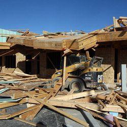 Wind damaged housing units under construction in Farmington, Thursday, Dec. 1, 2011.