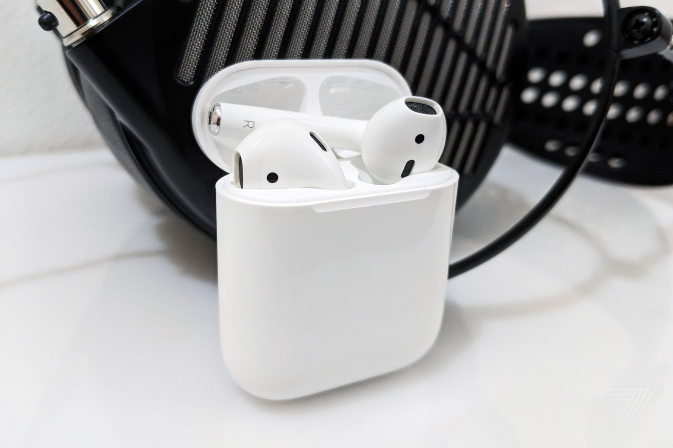 Apple AirPods in front of Audeze MX4