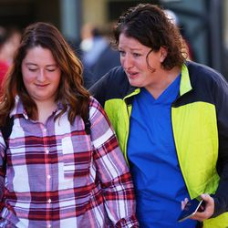 Adison Everett walk out of Mountain View High School in Orem with her mother, Gina, as parents arrive at the school to pick up their children after five students were stabbed in an apparent attack by a 16-year-old boy on Tuesday, Nov. 15, 2016.