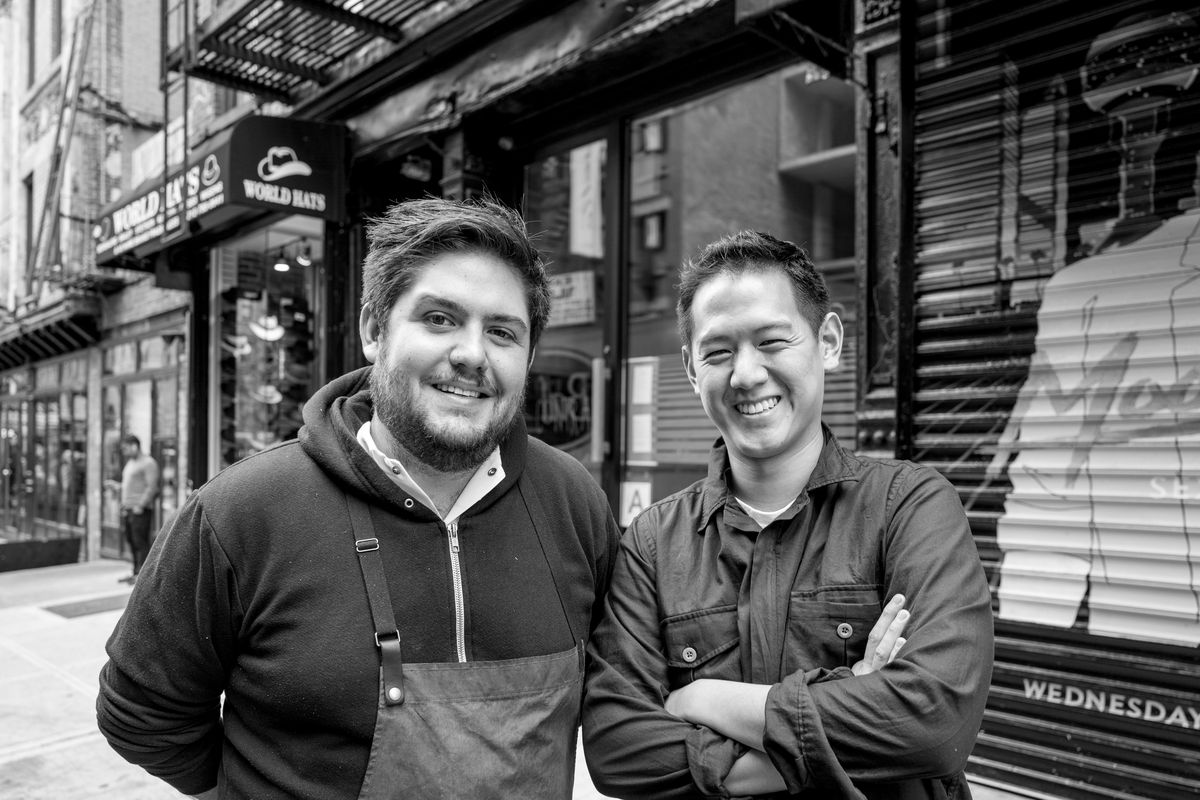 Fabián Von Hauske Valtierra and Jeremiah Stone stand near the entrance to Contra in a black and white photo