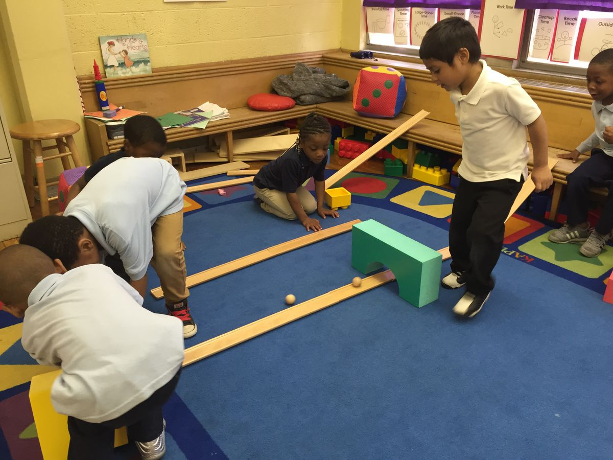"""Students in LaWanda Marshall's pre-Kindergarten class at the Carver STEM Academy regularly receive boxes with new toys like these ramps and balls that teach physics concepts through PNC's Grow Up Great program. """"It's like Christmas!"""" Marshall said."""