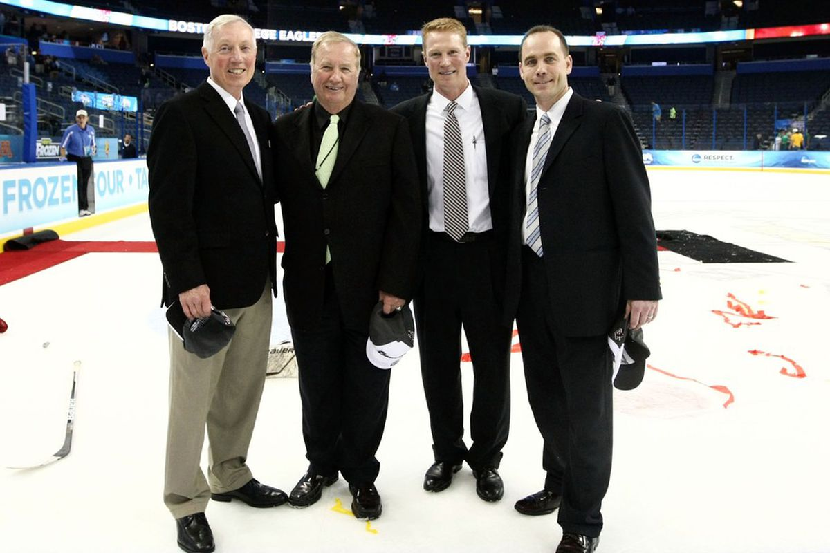 Mike Cavanaugh (far right) is in his first season as head coach at the University of Connecticut.