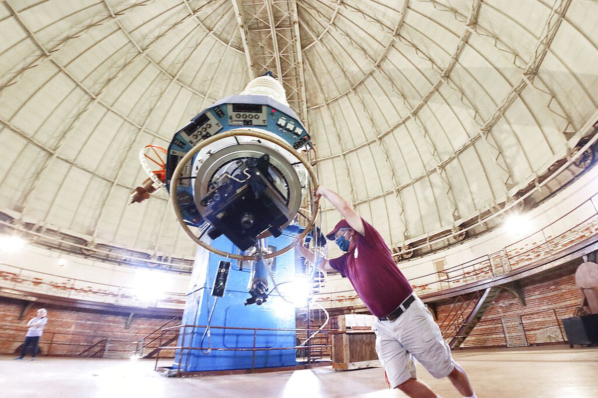 Built in the 1890's the world's largest refracting telescope is maneuvered Wednesday, June 10, 2020, by hand by Ed Struble, who has served for 30 years as director of building and grounds at the Yerkes Observatory in Williams Bay, Wis.