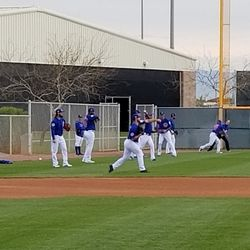 Cubs pitchers warm up before the workout