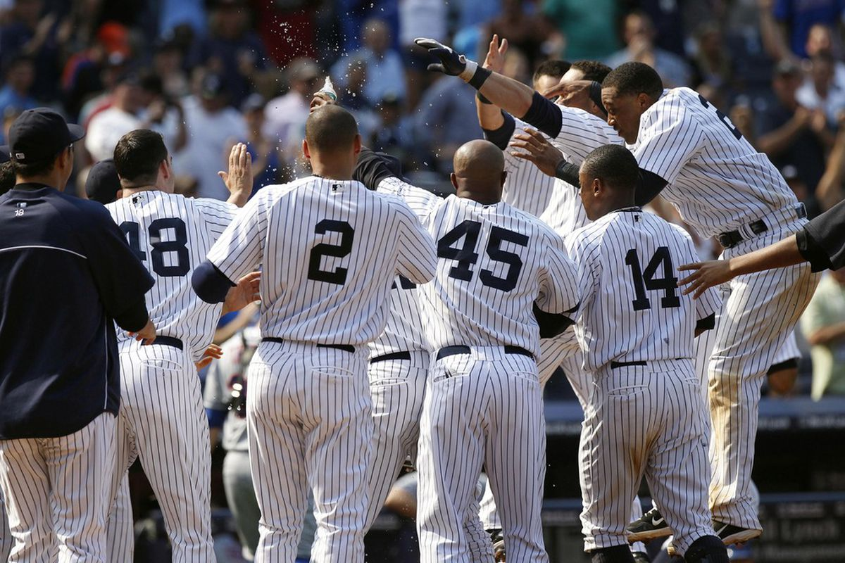 June 10, 2012; Bronx, NY, USA; New York Yankees catcher Russell Martin is mobbed by his teammates after hitting a walk-off home run against the New York Mets at Yankee Stadium. William Perlman/THE STAR-LEDGER via US PRESSWIRE