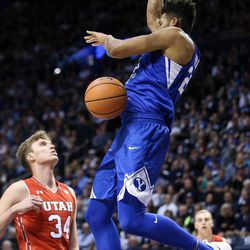 Brigham Young Cougars forward Yoeli Childs (23) dunks during the game against the Utah Utes at the Marriott Center in Provo on Saturday, Dec. 16, 2017.