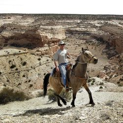 Mike Vanderhoof rides along the ridge above Salt Wash in the Sid's Mountain area. One really has to see the Swell to understand how powerful it is.