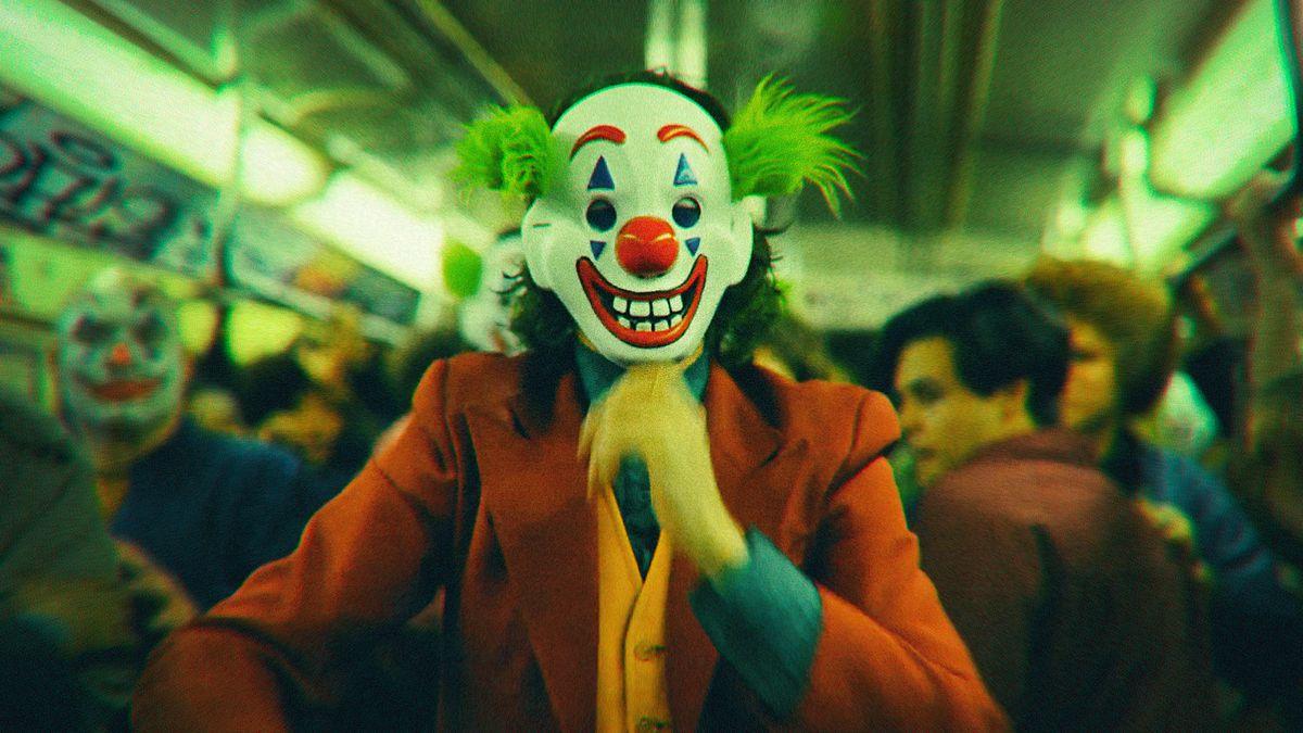 Joker riding the subway wearing a clown mask